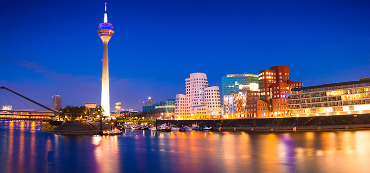 Colorful night scene of Rhein river at night in Dusseldorf. Photo: Getty Images/iStockphoto